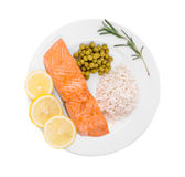 Fried salmon fillet on plate. With lemon and rice Stock Photo