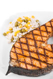 Fried salmon fillet. On plate with lemon and rice Royalty Free Stock Photo