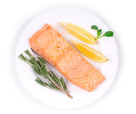 Fried salmon fillet on plate Royalty Free Stock Images