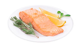 Fried salmon fillet on plate with lemon. Royalty Free Stock Image