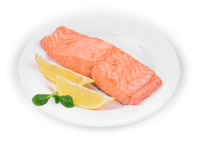 Fried salmon fillet on plate with lemon. Stock Photo