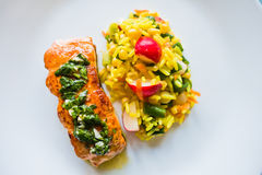 Fried salmon fish with rice and vegetables Stock Image