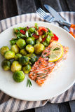 Fried salmon with lemon and brussels sprouts Stock Images