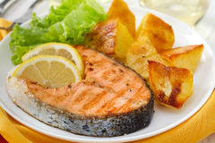 Fried salmon with lemon and potato Royalty Free Stock Images