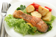 Fried salmon with lettuce and potato Royalty Free Stock Image