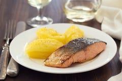Fried salmon with mashed potato on white dish Stock Photos