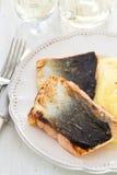 Fried salmon with mashed potato on white dish Stock Photo