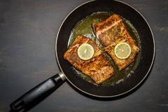 Fried salmon in the pan Royalty Free Stock Photo