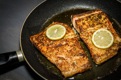 Fried salmon in the pan Royalty Free Stock Images