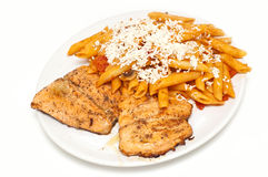 Fried salmon with pasta Royalty Free Stock Images