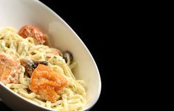 Fried Salmon Penne tube-shaped pasta with mushrooms tarragon and cheese creamy sauce Stock Photography