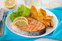 Fried salmon with potato Stock Images