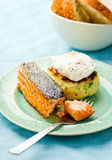 The fried salmon with a potato patty and poached egg Royalty Free Stock Images