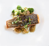 Fried salmon with potatoes capers Stock Photography