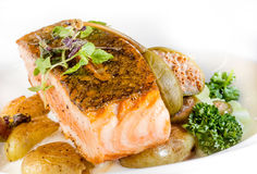 Fried salmon with potatoes. vegetarian lunch Royalty Free Stock Images