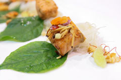 Fried salmon served with rice noodle and vegetable Stock Image