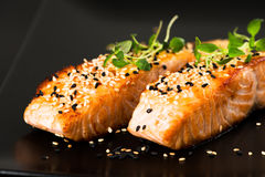 Fried salmon with sesame seeds and herbs Stock Photo
