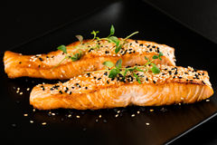 Fried salmon with sesame seeds and herbs Stock Photography