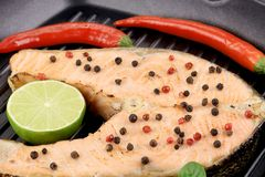 Fried salmon steak on grill. Stock Images