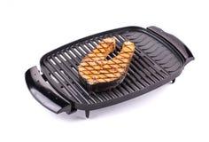 Fried salmon steak on grill. Stock Photo