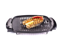 Fried salmon steak on grill. Royalty Free Stock Images