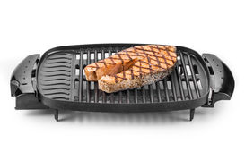 Fried salmon steak on grill. Royalty Free Stock Image