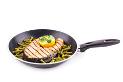 Fried salmon steak on pan as haute cuisine. Stock Images