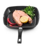 Fried salmon steak on pan. Royalty Free Stock Photo