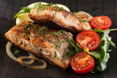 Fried salmon steak with vegetables Royalty Free Stock Image
