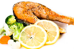 Fried salmon steak with vegetables Stock Photo