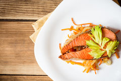 Fried salmon steak with vegetables on plate Royalty Free Stock Photos