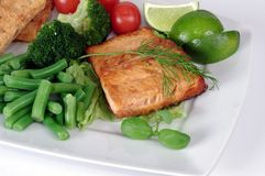 Fried salmon with vegetables Stock Image
