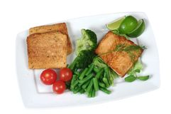 Fried salmon with vegetables Royalty Free Stock Photos