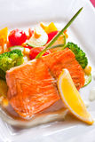 Fried salmon with vegetables. Appetizing fried salmon with vegetables stock photography