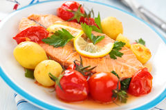 Fried salmon  with vegetables. Royalty Free Stock Photo