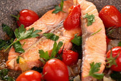 Fried salmon  with vegetables. Royalty Free Stock Photos