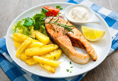 Fried salmon and vegetables Royalty Free Stock Image