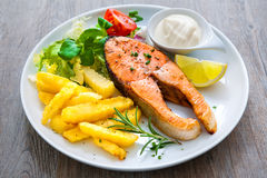 Fried salmon and vegetables Royalty Free Stock Photography