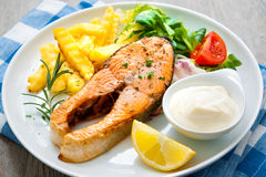 Fried salmon and vegetables Stock Image