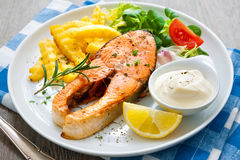 Fried salmon and vegetables Stock Images