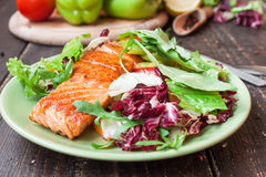Fried salmon with vegetables Royalty Free Stock Images