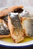 Fried salmon on white dish Royalty Free Stock Image