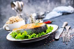 Fried salmon. On white plate and on a table royalty free stock photos