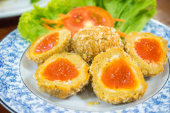 Fried salted egg stock images