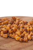 Fried salted Mexican corn on the wooden board Royalty Free Stock Images