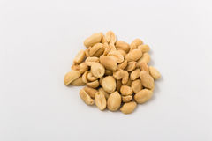 Fried salted peanuts on white background. snack. Stock Image