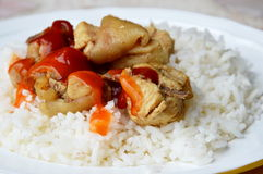 Fried salty chicken dressing tomato and chili sauce on rice Stock Photography