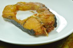 fried salty striped catfish slice on dish royalty free stock image