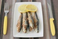 Fried sardines with lemon Royalty Free Stock Photography