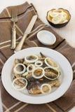 Fried sardines with onion Royalty Free Stock Photos